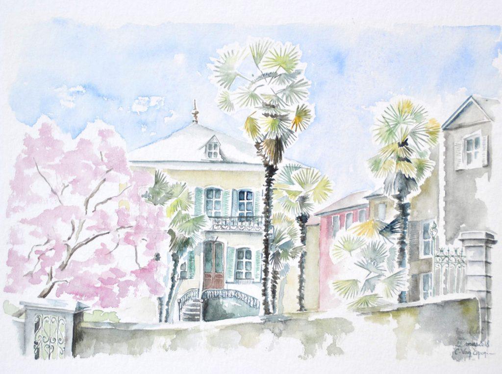 à l'aquarelle, une maison bourgeoise d'un étage. devajt sur la gauche un volumineux magnolia en fleurs roses, sur la droite deux palmiers